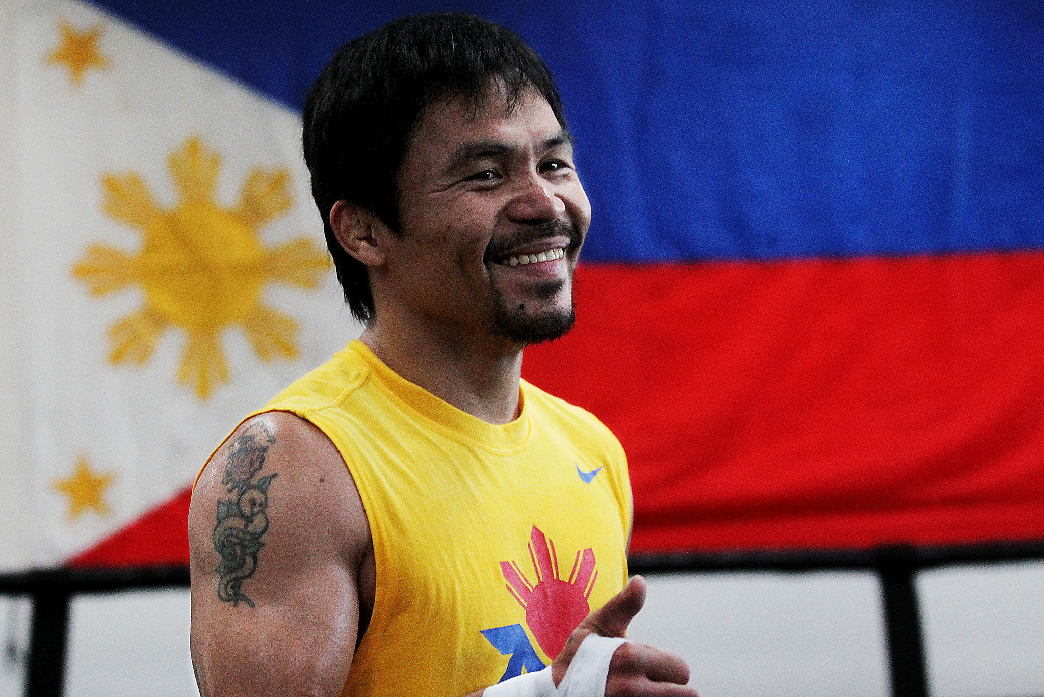 manny pacquiao On thursday, boxing great manny pacman pacquiao stood before a cheering  crowd and flashing cameras, his arm hoisted above his head.