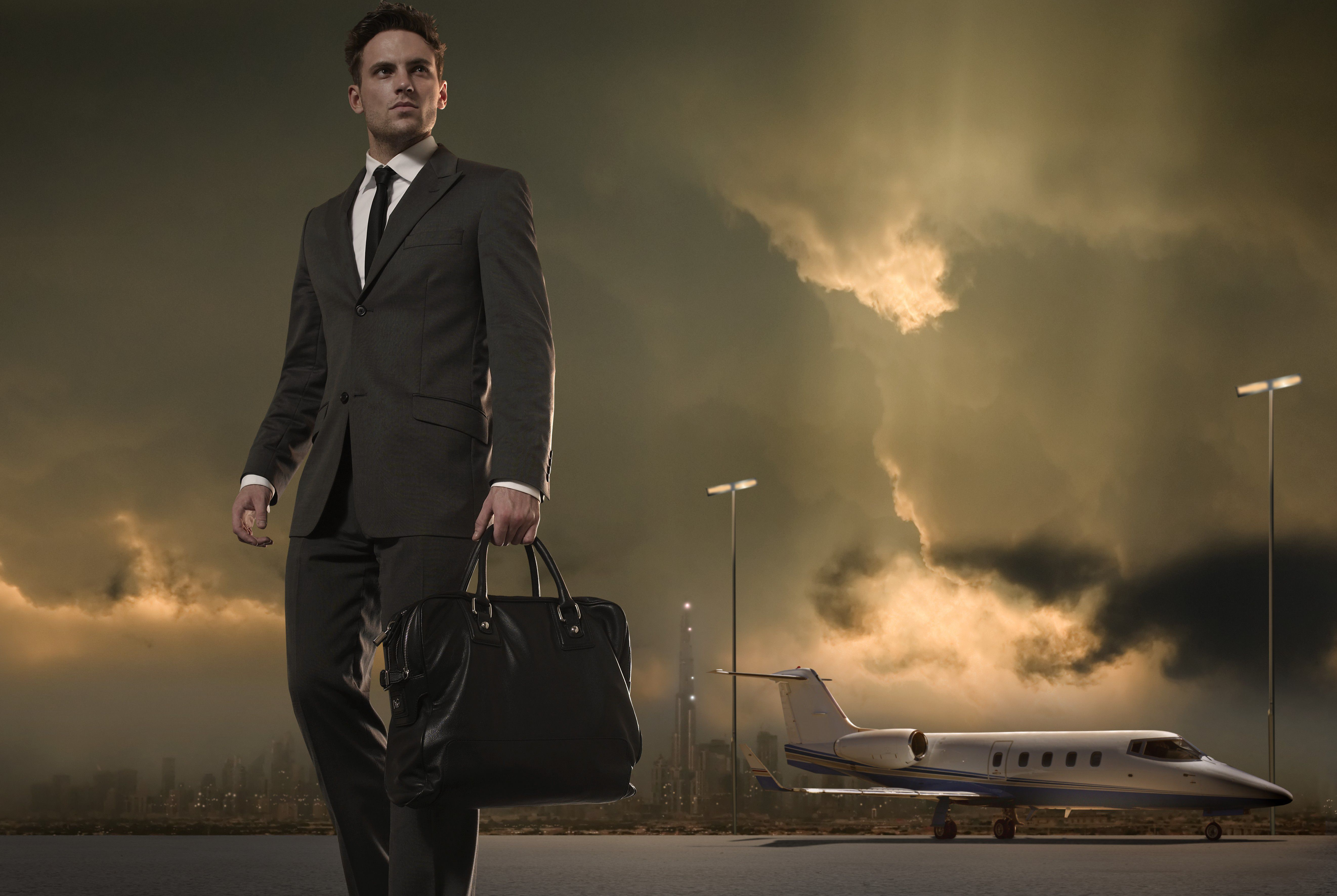 Businessman Walking Across Tarmac