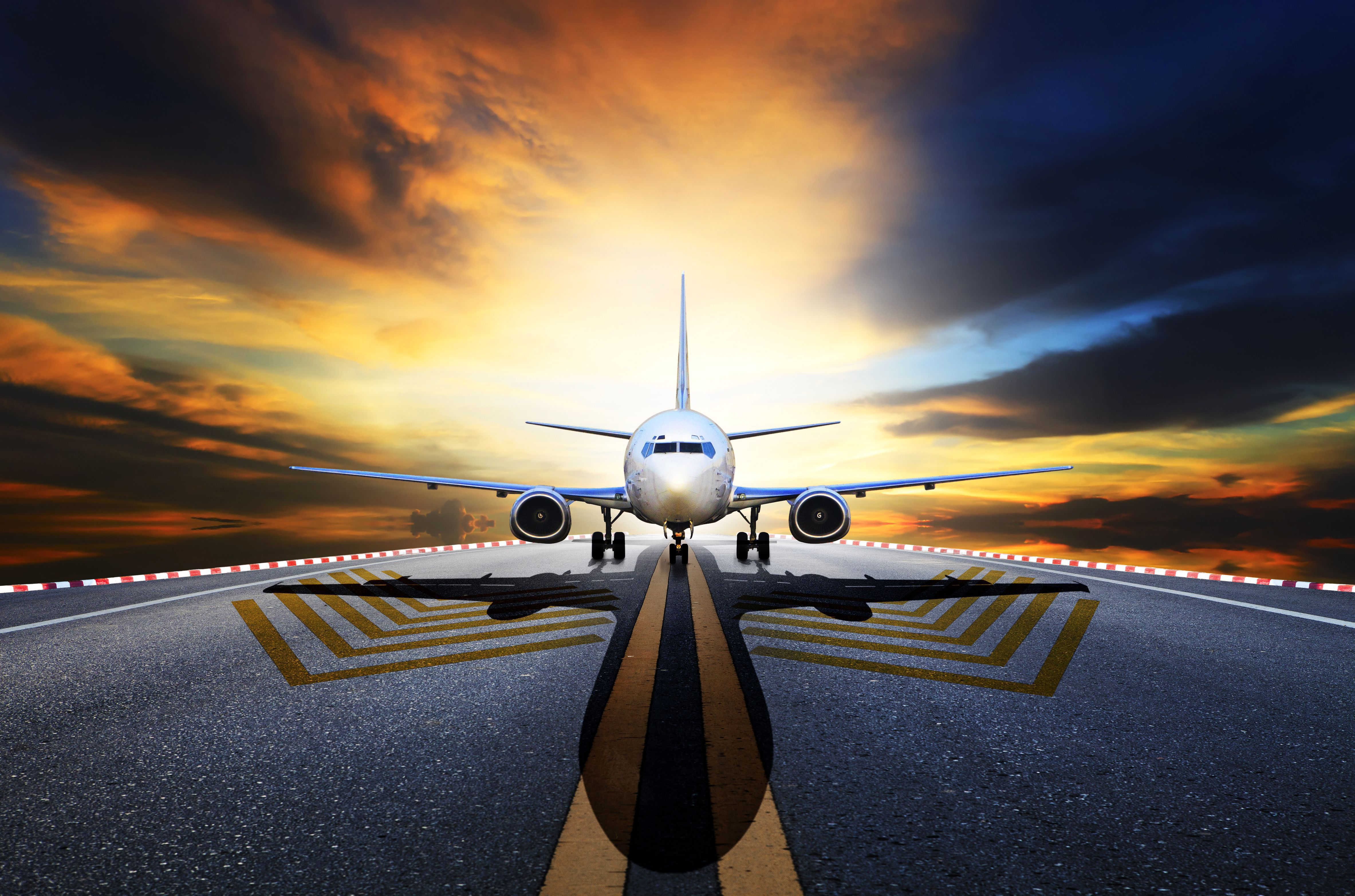Passenger Jet Plane Preparing To Take Off From Airport Runways Against Beautiful Dusky Sky
